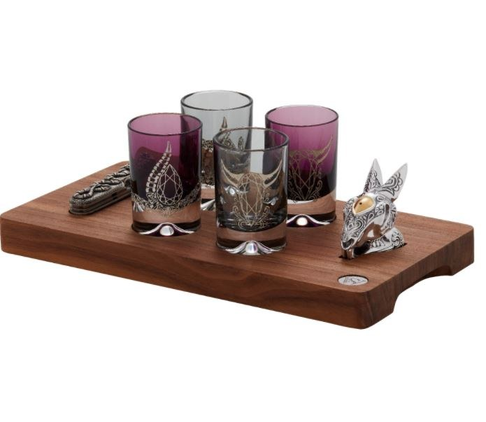 A set of the most beautiful four colored glasses on a special tray